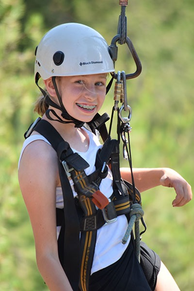 teen girl on ropes course